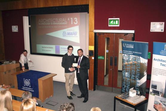 Eddie Weir presents award to student of the university of ulster
